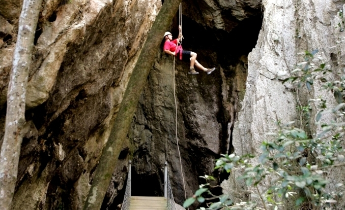 Abseiling action at Capricorn Caves