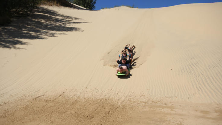 Go sand boarding down the sand dunes on this Island Adventure ex Agnes Water
