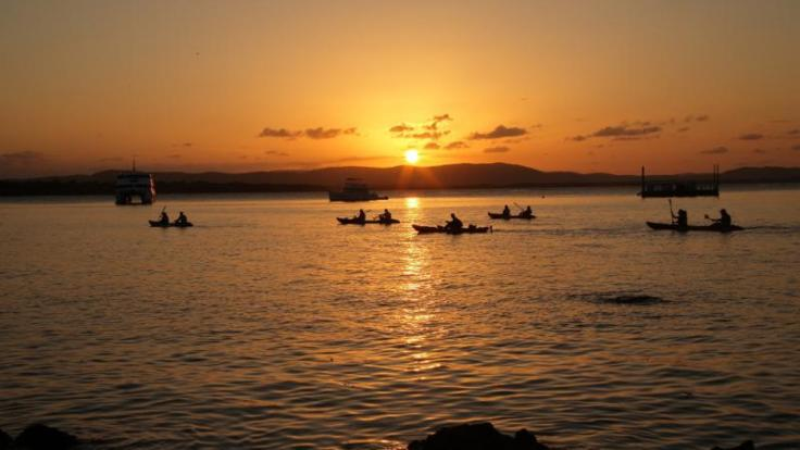 Enjoy stunning scenery on this sunset kayak tour ex 1770 and Agnes Waters