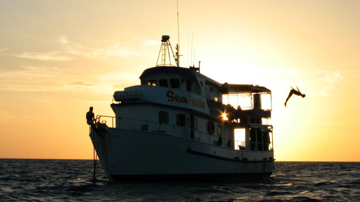 Liveaboard vessel at Sunset