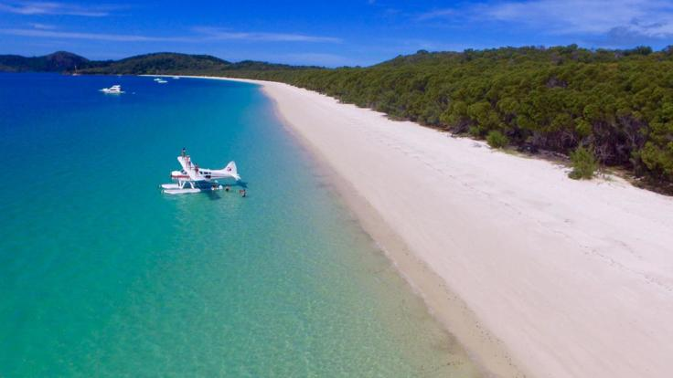 Aerial Shot of Seaplane off Whitehaven Beach