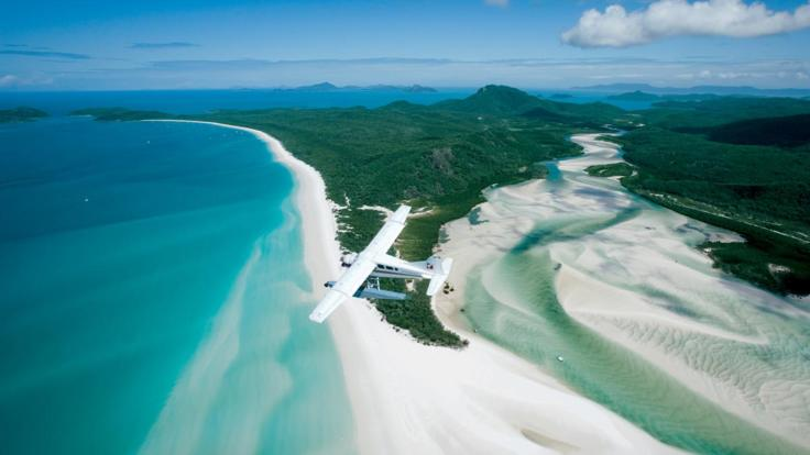 Seaplane over Hill Inlet and Whitehaven beach Whitsundays