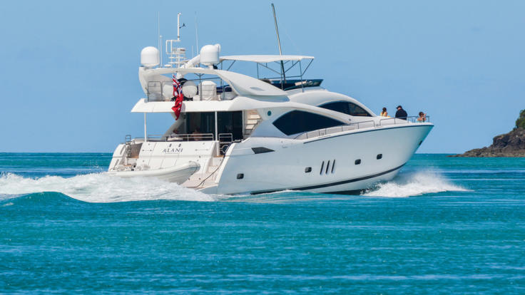 Luxury charter yacht underway on the Great Barrier Reef in the Whitsunday Islands