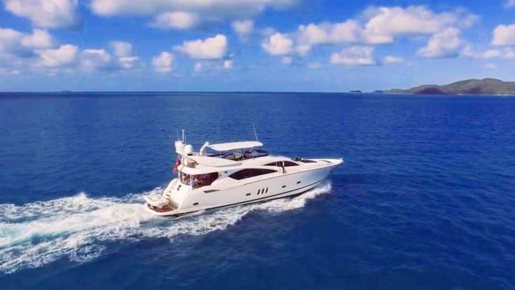 Luxury charter yacht under steam on the Great Barrier Reef