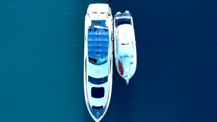 Aerial view of luxury charter yact at anchor on the Great Barrier Reef in the Whitsundays