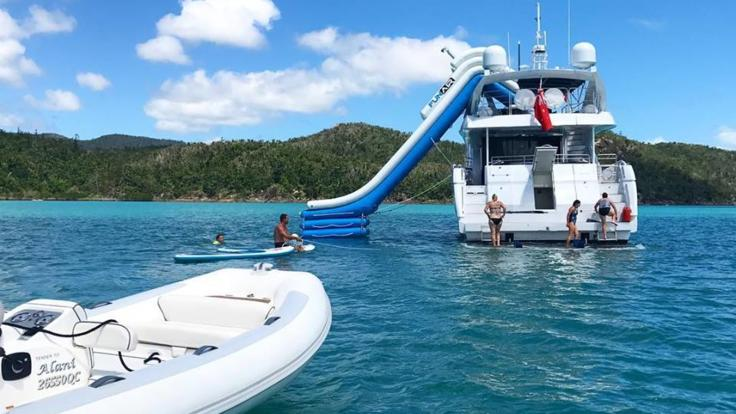 Hamilton Island Private Charte Yact at anchor with Funair slide in play