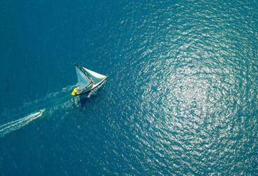 Barrier Reef Australia: Drone image of Whitsunday dive boat under sail