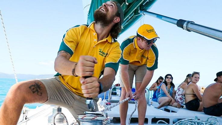 Crew winching onboard Whitsunday Sailing liveaboard