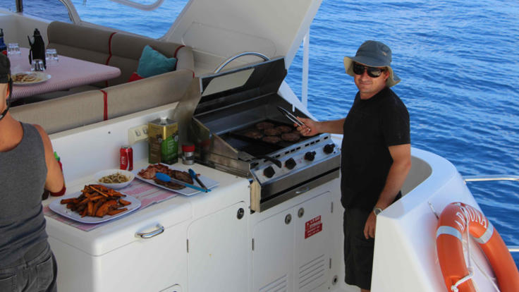 Barbeque on aft deck of private motor yacht on the Great Barrier Reef in Australia