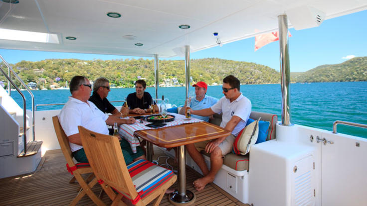 Meals can be enjoyed on aft deck on Cairns charter yacht