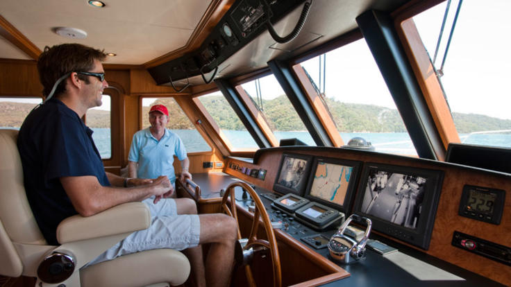 Skippers control room on board Cairns private charter yacht
