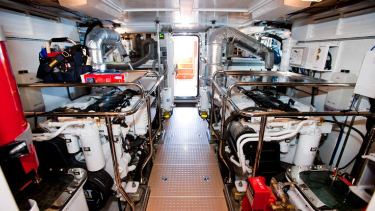 The spick and span engine room of the luxury Cairns private charter yacht