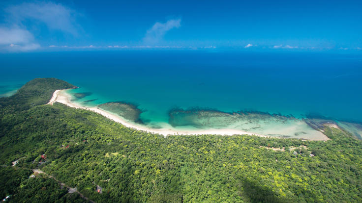 Aerial Shot of Cape Tribulation in your airplane seat