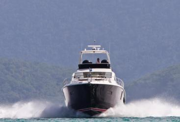 Luxury Motor Yacht under steam departing Hamilton Island in the Whitsundays