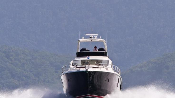 Whitsunday Charter Yachts - Hamilton Island - Luxury Motor Yacht under steam departing Hamilton Island in the Whitsundays