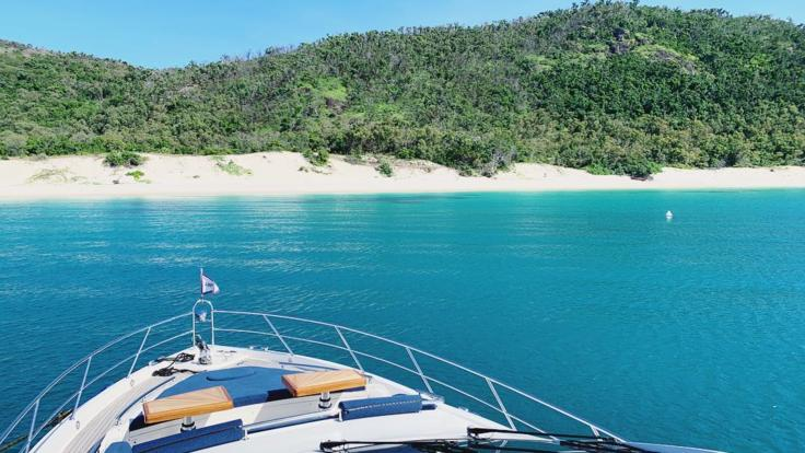 Explore the fringing coral reef off Chalkies Beach | Whitsunday luxury charter | Private Charter Boat