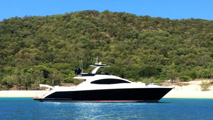 Luxury charter yacht at anchor on the reef in the Whitsunday Islands Great Barrier Reef Australia