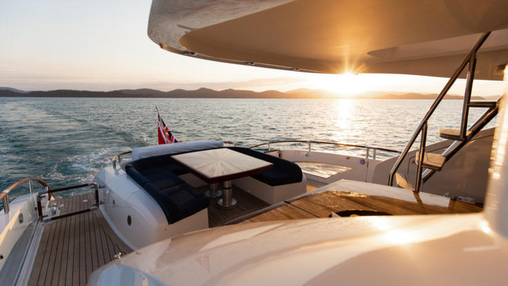 Enjoy the sunset from the back deck on your Whitsunday charter yacht