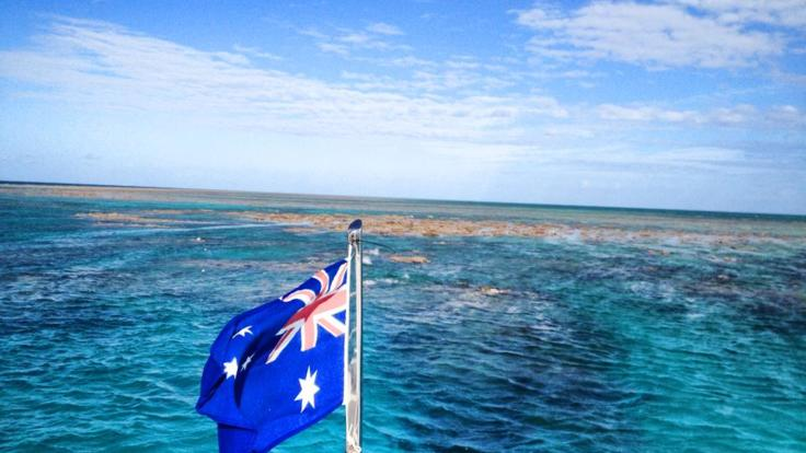 Australian flag on our luxury charter boat on the Great Barrier Reef