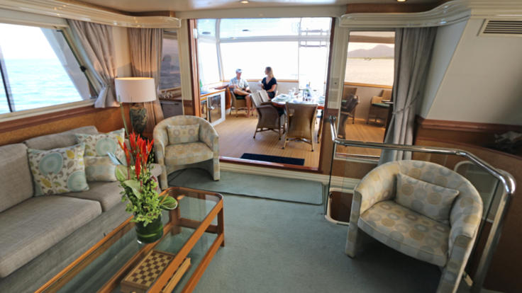 Lovely air-conditioned saloon on private yacht charter, Great Barrier Reef