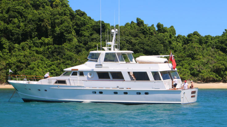 Luxury motor yacht at anchor on the Great Barrier Reef
