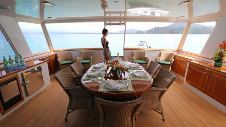 Comfortable saloon seating on the private charter yacht, Port Douglas, Great Barrier Reef