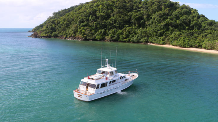 Aerial view of luxury motor yacht on the Great Barrier Reef - Port Douglas