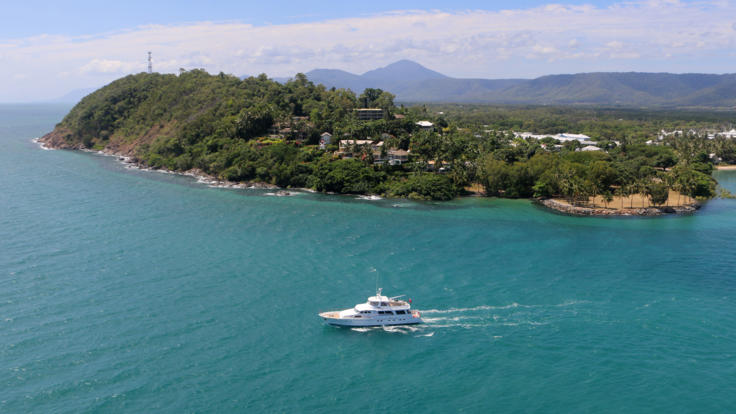 Aerial view of luxury charter yacht leaving Crystalbrook Superyacht Marina Port Douglas