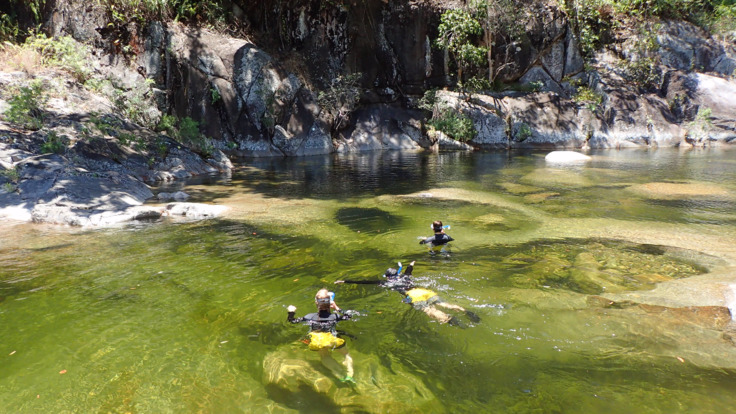 Swimming in crystal clear waters at Behana Gorge