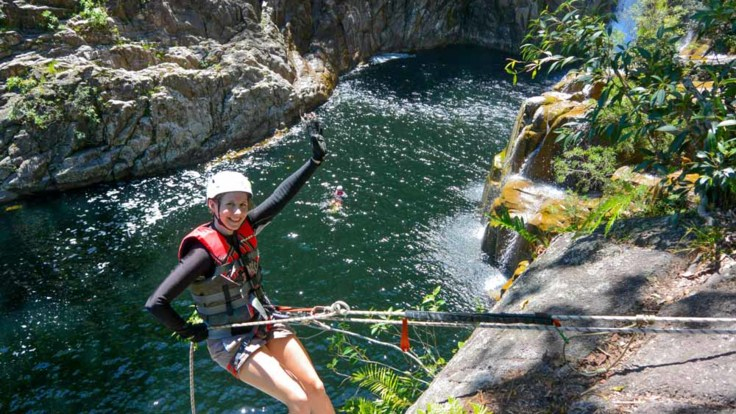 Abseiling action at Behana Gorge, Tropical North Queensland