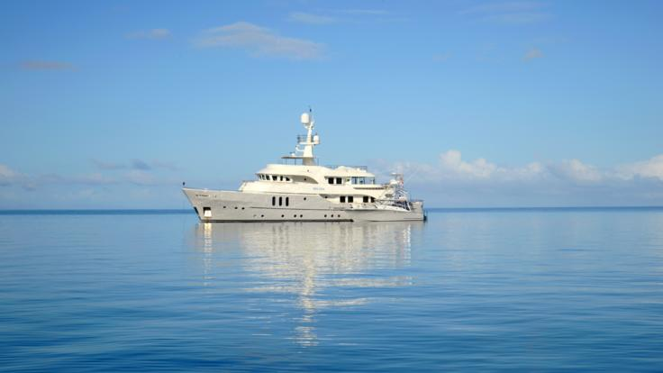 Superyacht and Fishing tender on the Great Barrier Reef