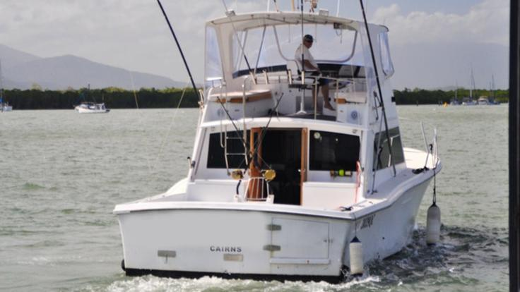 Cairns charter boat heading to Great Barrier Reef