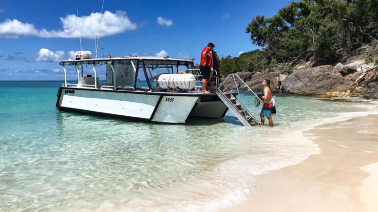 Stair access to hop on and off the Whitsundays charter boat