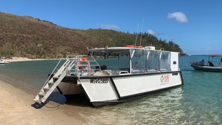 Visit tropical Whitsunday beaches on private charter boat