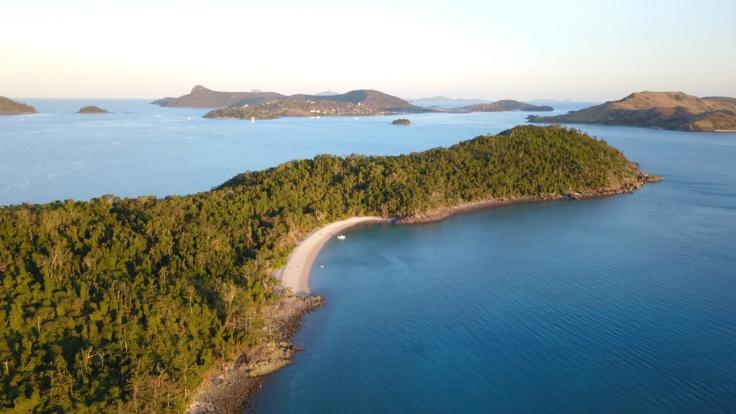 Aerial shot of the charter boat & Whitsunday Islands