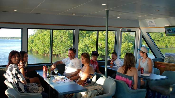 Relaxing onboard Cairns sunset cruise