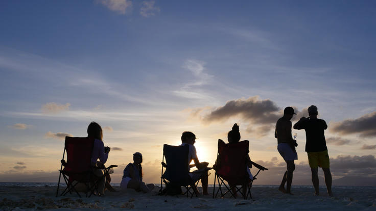 Cruise ship guests enjoying sunset drinks on Sudbury Cay on the Great Barrier Reef