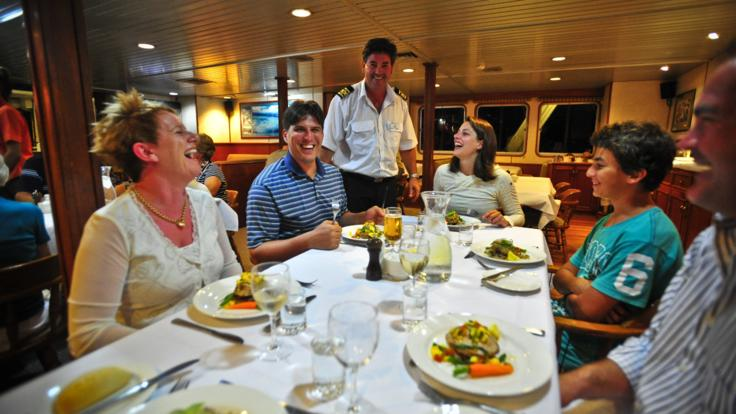Dinner time is like a family gathering on our small Cairns cruise ships