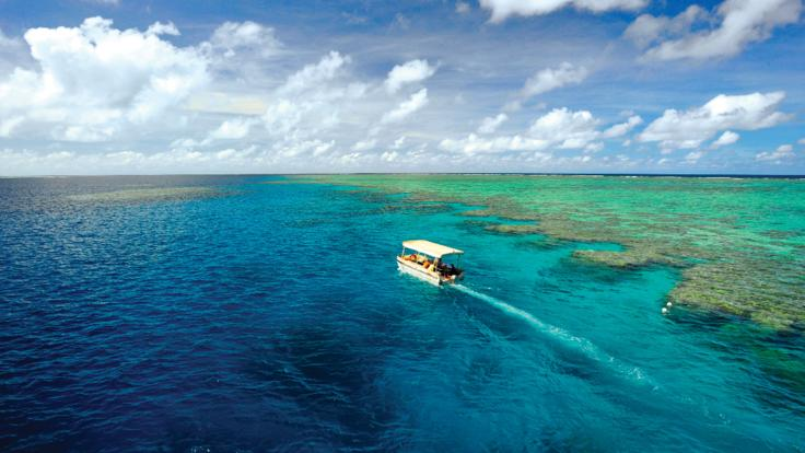 Glass bottom boat tours around the Great Barrier Reef on the cruise ships expedition boat