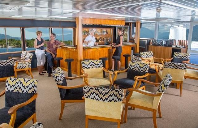 Relax in the upper deck lounge bar on the cruise ship