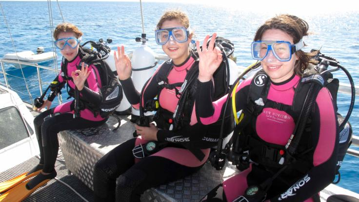 Getting ready to scuba dive, Great Barrier Reef