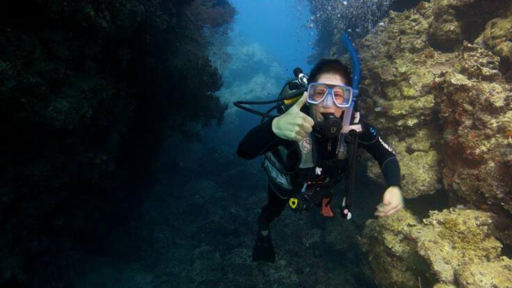 Cairns Dive Boat Tours - One of our happy divers explore the Great Barrier Reef