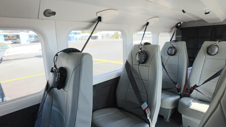 Interior view of fixed wing aircraft and comfortable leather seating on our Cairns scenic flight