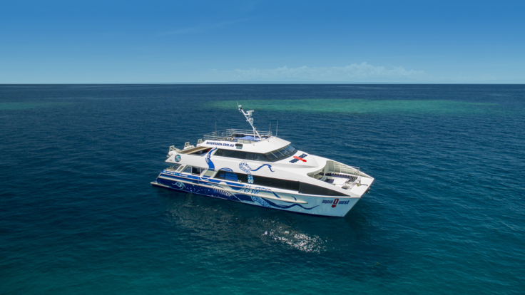 Aerial view Great Barrier Reef tour boat in Port Douglas