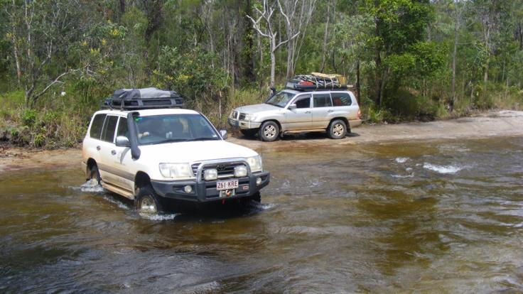 Crossing creeks in 4WDs, touring Cooktown and the Wild North in Cape York, Australia