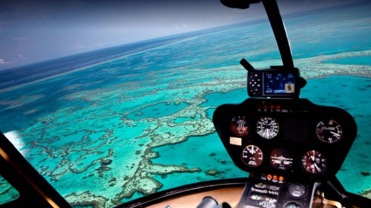 View the Great Barrier Reef from above on a helicopter scenic flight