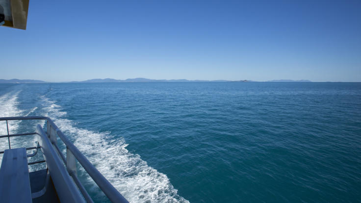 Leave behind the mainland toward the Great Barrier Reef