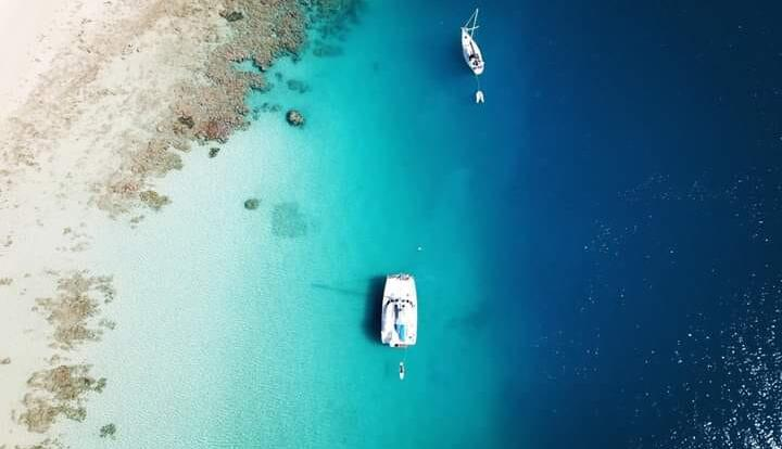Whitsunday Yacht Charter - Aerial View of Yacht at Anchor