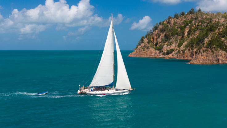 Aerial view of sail boat in the Whitsunday Islands on the Great Barrier Reef of Australia