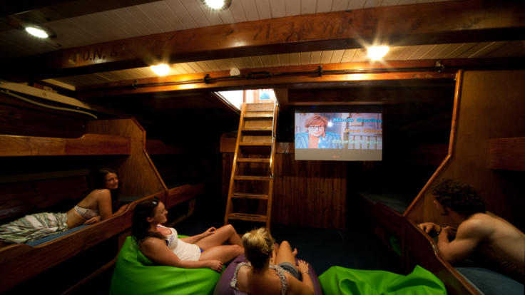 Relaxing on-board cinema - Sailing holidays Whitsundays Great Barrier Reef - Australia